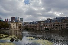 Skyline of The Hague with the modern office buildings behind the Mauritshuis museum and the Binnenhof parliament building next to stock images