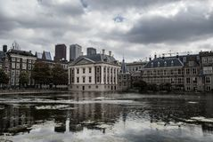 Skyline of The Hague with the modern office buildings behind the Mauritshuis museum and the Binnenhof parliament building next to royalty free stock image