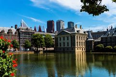 Skyline of The Hague with the modern office buildings behind the Mauritshuis museum and the Binnenhof parliament building next to royalty free stock images