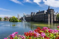 Skyline of The Hague with the modern office buildings behind the Mauritshuis museum and the Binnenhof parliament building next to stock image