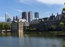 Skyline of The Hague with the modern office buildings behind the Mauritshuis museum and the Binnenhof parliament building next to stock photography