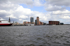 Skyline of Hamburg with Philharmonic concert hall. Hamburg's cultural highlights are the new Philharmonic concert hall on top of the Kaispeicher A with a Stock Photography