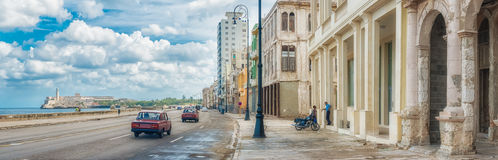 The skyline of Havana along Malecon avenue. The skyline of Havana with old decaying buildings on the foreground along Malecon avenue Royalty Free Stock Photos