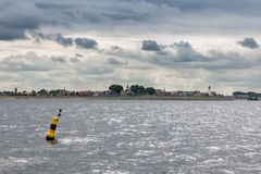 Skyline historic Dutch fishing village Urk covered with cloudy sky Royalty Free Stock Photography