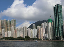 Skyline of Hong Kong Island. Hong Kong - July 2016 Skyline of Hong Kong with the Victoria Peak in the background. Tall buildings lined the coastal areas in Hong stock photography