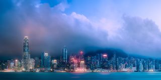 Skyline of Hong Kong in mist from Kowloon, China. Evening view and skyline of Hong Kong in mist from Kowloon, China royalty free stock images