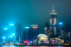 Skyline of Hong Kong in mist from Kowloon, China. Night panoramic view and skyline of Hong Kong in mist from Kowloon, China stock images