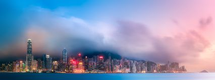 Skyline of Hong Kong in mist from Kowloon, China. Panoramic view and skyline of Hong Kong from Kowloon, China royalty free stock images