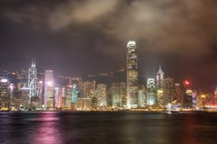 Skyline of Hong Kong  at Night. With the colours reflecting off the harbour Stock Photography