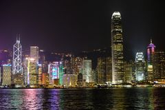 Skyline of Hongkong at night. In Victoria Harbour Royalty Free Stock Image