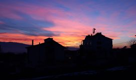 Skyline of houses at sunset Stock Photos