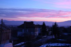 Skyline of houses at sunset Royalty Free Stock Photo