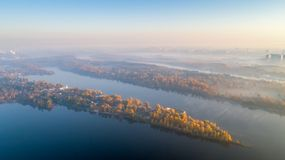 Skyline, Kiev city with beautiful morning sky. Pedestrian bridge. Left bank the Dnieper River. stock photo