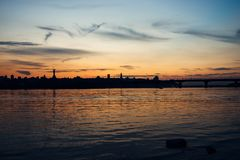 Skyline, Kiev city in the evening. The right bank at sunset across the Dnieper River. Silhouette of a city on a sunset Stock Images