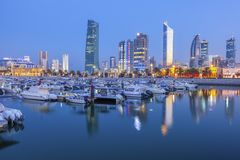 Skyline of Kuwait City at evening royalty free stock photo