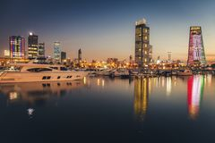Skyline of Kuwait City at evening stock photos
