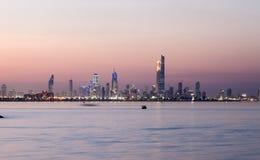 Skyline of Kuwait city at night Royalty Free Stock Photo