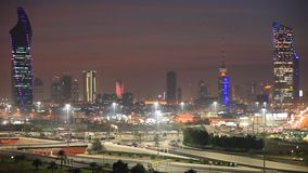 Skyline of Kuwait City at night stock footage