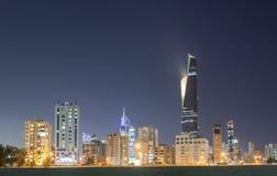Skyline of Kuwait city at night Stock Image