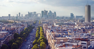 The Skyline of La Defense in Paris. A broad boulevard leads to the skyscrapers of La Defense in warm afternoon light Stock Photos