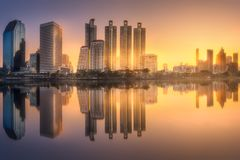 Skyline at lake in Benjakitti park Bangkok. City downtown at night with reflection of skyline at lake in Benjakitti park Bangkok,Thailand Stock Image