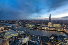 The skyline of London by night. Panoramic view over the skyline of London by night along the Thames river to the Tower Bridge royalty free stock images