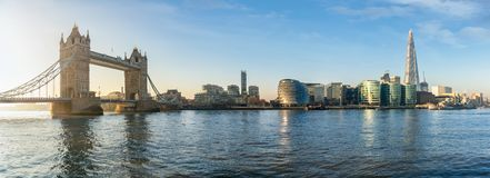 The skyline of London, UK, during a sunny morning. The iconic urban skyline of London, UK, during a sunny morning: from the Tower Bridge to London Bridge stock photo