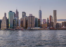 The skyline of lower manhattan just before sunset on a winter ev Royalty Free Stock Photo