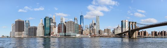 Panoramic view of downtown Manhattan from Brooklyn. Skyline of lower Manhattan with modern buildings and ancient Brooklyn bridge. Looks like the financial Stock Photography