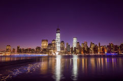 Skyline of lower Manhattan of New York City from Exchange Place. At night with World Trade Center at full height of 1776 feet May 2013 Stock Photo