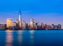 Skyline of Lower Manhattan at night. Skyline of lower Manhattan of New York City from Exchange Place at night with World Trade Center at full height of 1776 feet Stock Image