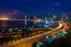 Skyline of Luanda and its seaside during the blue hour. Many lights and high rise buildings Royalty Free Stock Photos