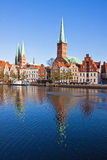 Skyline of Lubeck old town, Germany. Skyline of Lubeck old town with Marienkirche (St. Mary's Church) and Petrikirche (St. Peter's Church) reflected in Trave Stock Photos