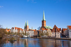 Skyline of Lubeck old town, Germany. Skyline of Lubeck old town with Marienkirche (St. Mary's Church) and Petrikirche (St. Peter's Church) reflected in Trave Royalty Free Stock Images