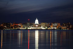 Skyline of Madison Wisconsin at night. The Madison Wisconsin skyline during early evening has the reflections of the cities lights in Lake Menona stock image