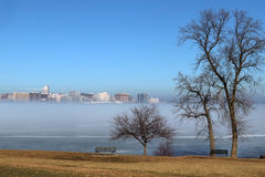 Skyline of Madison Wisconsin and winter mist. Downtown skyline of Madison Wisconsin with State Capitol building as seen across lake Monona thru a mist from Royalty Free Stock Image