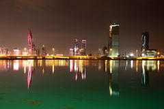 Skyline of Manama at night Stock Photo
