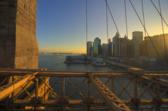 Skyline manhattan. The skyline of manhattan new york vieuw from brooklyn bridge at sunset Royalty Free Stock Images