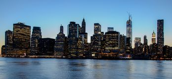Skyline of Manhattan at sunset, closed to night. Nice view since Brooklyn. Long exposure stock photography