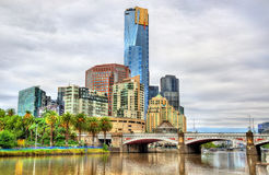 Skyline of Melbourne along the Yarra River and Princes Bridge - Australia Stock Image