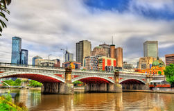 Skyline of Melbourne along the Yarra River and Princes Bridge - Australia Royalty Free Stock Images