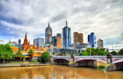 Skyline of Melbourne along the Yarra River and Princes Bridge - Australia Stock Photos