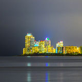 Skyline of Miami sunny isles by night with reflections at the oc Stock Image