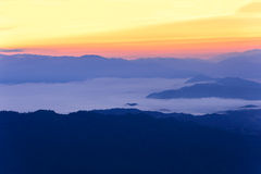 Skyline with mist and mountain at Doi Pha Hom Pok, the second highest mountain in Thailand, Chiang Mai, Thailand. Royalty Free Stock Image