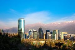Skyline of Modern buildings in Santiago de Chile. With The Andes Mountain Range in the back Royalty Free Stock Photography