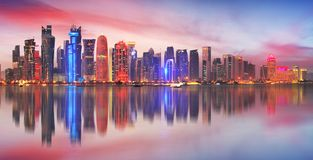 Skyline of modern city of Doha in Qatar, Middle East. - Doha`s C. Orniche in West Bay, Doha, Qatar stock photos