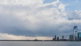 Skyline of New Jersey over Hudson River, viewed from Manhattan, New York, USA. Skyline of Jersey City, New Jersey under clouds over Hudson River, viewed from stock photos