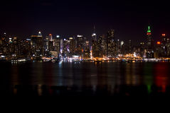 Skyline of New York City At Night Stock Image