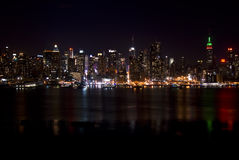 Skyline of New York City At Night Stock Photography