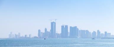 Free Skyline Of Manama City, Bahrain. Skyscrapers In The Haze Royalty Free Stock Photography - 48016467